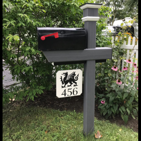 A custom version of the Essential Mailbox Post in an Arctic Blend color with one of our custom engraved signs