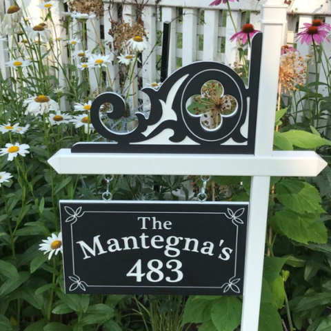 Custom black-white-black engraved house number sign with family name and decorative accents, plus engraved celtic corner
