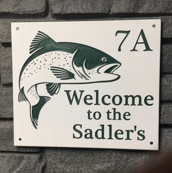 Custom green and white engraved camp site number sign with fish