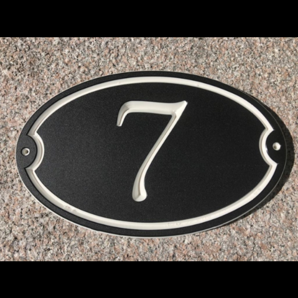 Custom house number sign on oval shaped black-white-black color core