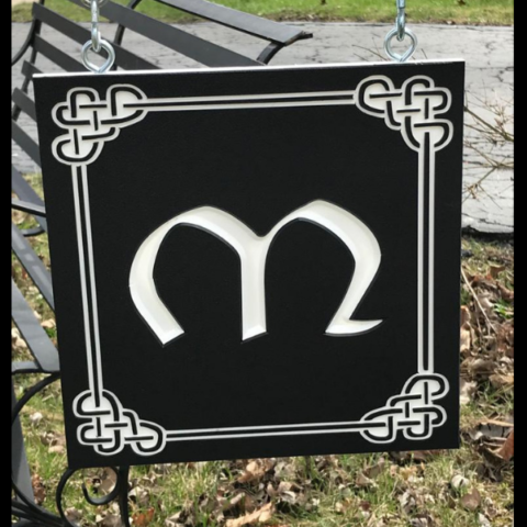 Custom sign with initial M on black-white-black color core