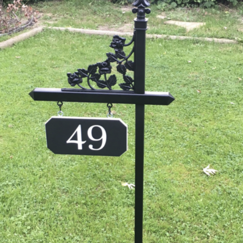 Custom white and black house number sign on one of our black lawn signs with rose scroll