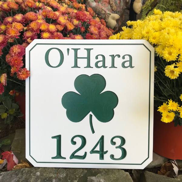 Engraved shamrock sign with last name and house number using white-green-white color core