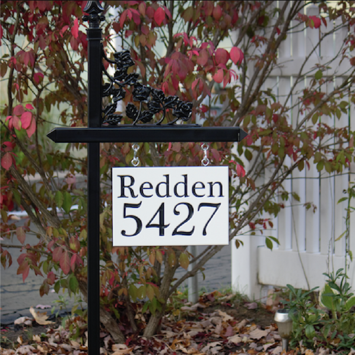 Custom black lawn sign holder with house number with family name on a customized engraved sign made from white-black-white color core. Contact us for details if you're interested in a black lawn sign.