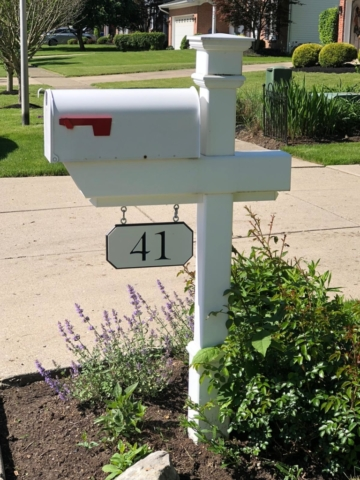 Kensington Mailbox Post with custom engraved house number sign.