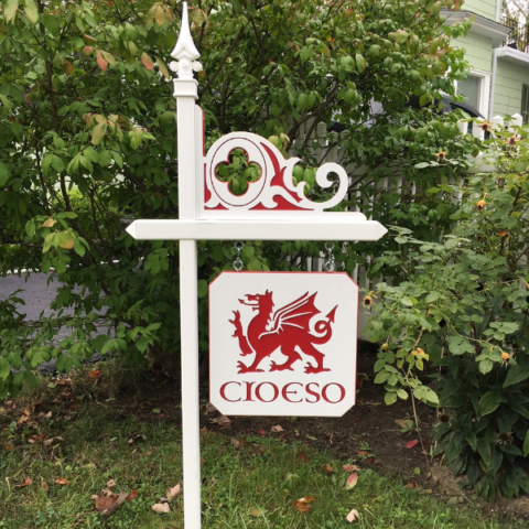 White lawn sign holder with custom red Celtic Corner and red Welsh dragon sign