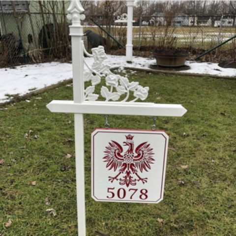 White lawn sign holder with rose scroll and white-red-white engraved sign with Polish falcon